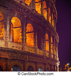view of Colosseum at night, Rome, Italy