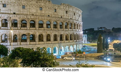 view of Colosseum illuminated at night timelapse in Rome, Italy