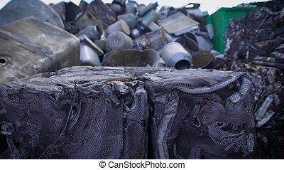 View of compressed metal waster on junkyard of recycling...