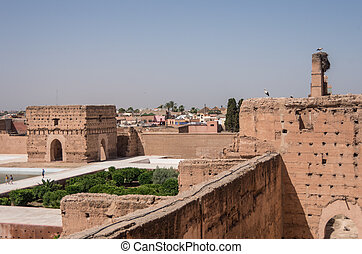 View of courtyard of El Badi Palace (Palais El Badi) in Marrakech with storks on roof , Morocco