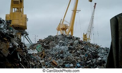 View of cranes on scrap yard. - Working cranes on scrap...