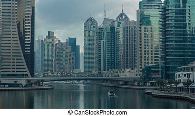 View of Dubai Marina Towers and canal in Dubai morning timelapse