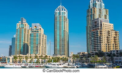 View of Dubai Marina Towers and canal in Dubai timelapse hyperlapse