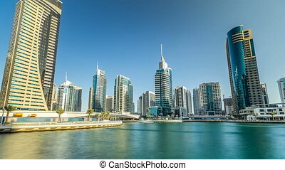 View of Dubai Marina Towers and canal in Dubai timelapse