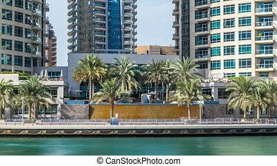 View of Dubai Marina Towers and waterfall in Dubai timelapse hyperlapse