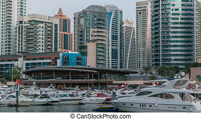 View of Dubai Marina Towers reflected in water of canal in...