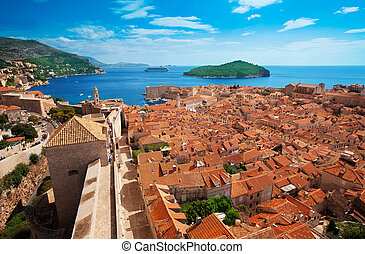Old town of Dubrovnik with Lokrum island on background with red roofs