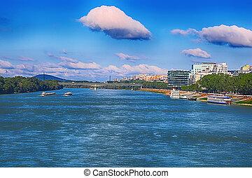 View of Dunabe river, Lafranconi bridge, River Park complex right in Bratislava, Slovakia