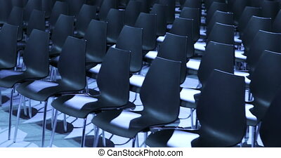 View of empty Conference hall with comfortable seats. conference room for the business audience. Free empty chairs or armchairs. In anticipation of the beginning of the seminar or lecture