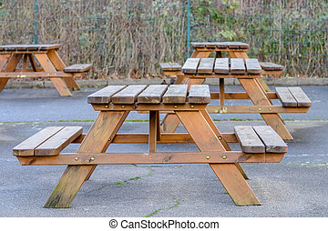 empty wooden tables with benches