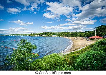 View of Endicott Rock Park Beach along Lake Winnipesaukee in Weirs Beach, Laconia, New Hampshire.