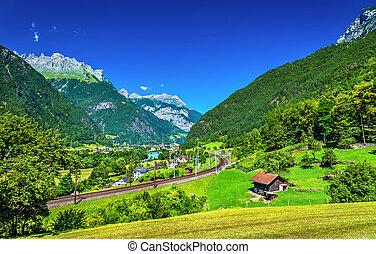 View of Erstfeld, a village in Swiss Alps