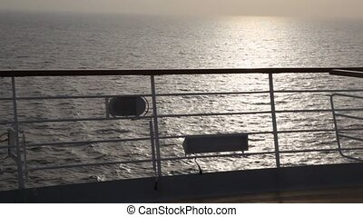 view of evening sea from deck of cruise ship
