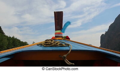view of fabric flapping on longtail boat - view of fabric...