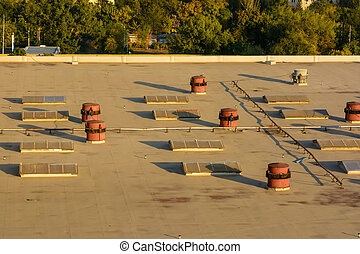 View of factory rooftop on sunny day