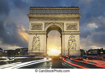 View of famous Arc de Triomphe at sunset, Paris