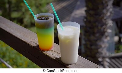 View of few served drinks with straw of terrace of resort -...