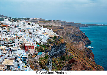 View of Fira Greek town with traditional white houses on Santorini island