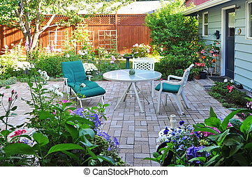 View of flower garden and backyard patio area - Brick floor...