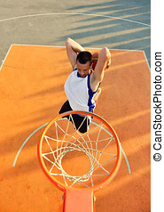 View of flying ball to basket from top. Face gesture.