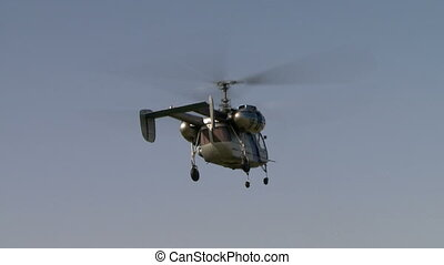 View of flying helicopter in clear sky