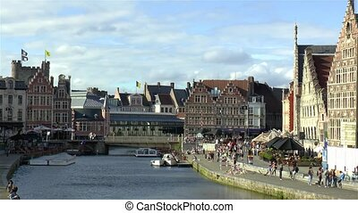 Gravensteen Castle and traditional buildings by the Grasbrug Bridge and Leie River in Ghent, Gent, Belgium.