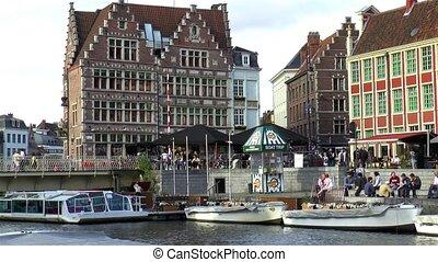 Traditional buildings by the Grasbrug Bridge and Leie River in Ghent, Gent, Belgium.