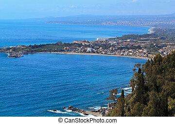 view of giardini naxos from taormina