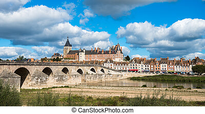 View of Gien with the castle and the old bridge across the Loire river, France