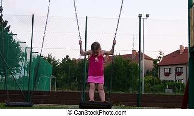 View of girl on the swing