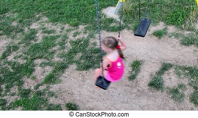 View of girl on the swing. View from the top