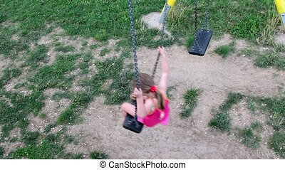 View of girl on the swing View from the top.