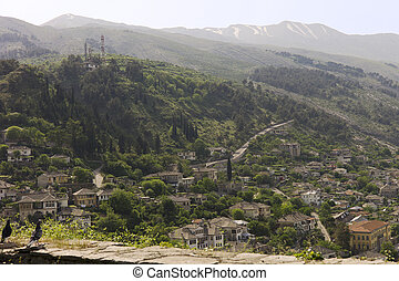 """Gjirokastër is a city in southern Albania. Its old town is inscribed on the World Heritage List as """"a rare example of a well-preserved Ottoman town, built by farmers of large estate."""" Gjirokastër is situated in a valley between the Gjerë mountains and the Drino River, at 300 m (984 ft) above sea ..."""