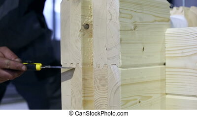 View of glued profiled timber as building material, close-up