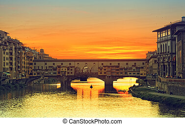 View of Gold (Ponte Vecchio) Bridge in Florence on a sunset