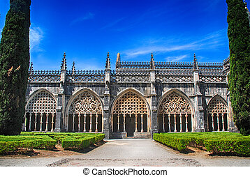 View of gothic medieval Batalha Monastery and ornamental garden, Portugal