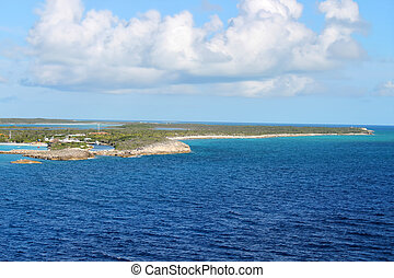 The island of Half Moon Cay in the Bahamas with beautiful turquoise blue waters