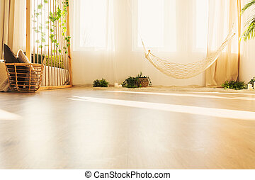 View of hammock in room - Low angle view of hammock in warm...
