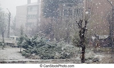 View of heavy snowfall during daytime through the window - ...