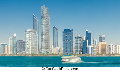 View of high skyscrapers on a corniche in Abu Dhabi...