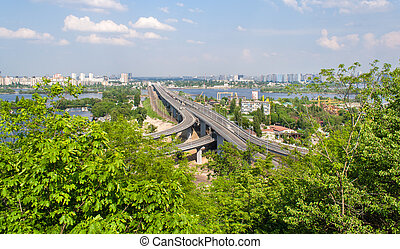 View of highway and railway bridges from a hill over the Dnieper river