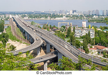 View of highway and railway bridges from a hill over the Dnieper river. Kyiv, Ukraine
