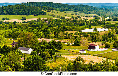 View of hills and farmland in Virginia's Piedmont, seen from Sky Meadows State Park.