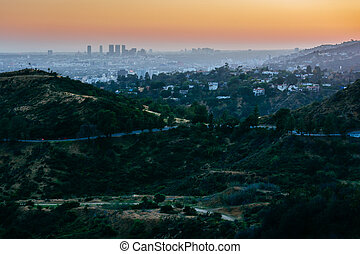 View of Hollywood and hills in Griffith Park at sunset, from Griffith Observatory, Los Angeles, California.