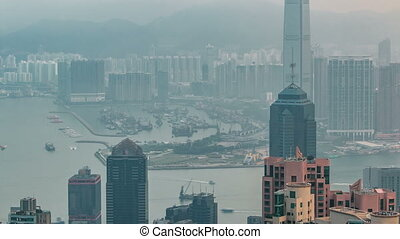 View of Hong Kong from Victoria peak in a foggy morning timelapse.