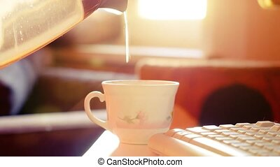 View of hot water pouring into hot cup or mug of coffee or tea, with steam vapour blurred background. 1920x1080