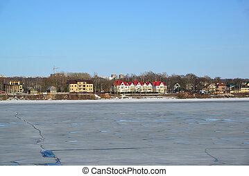 view of houses on shore Volga River in Yaroslavl, Russia