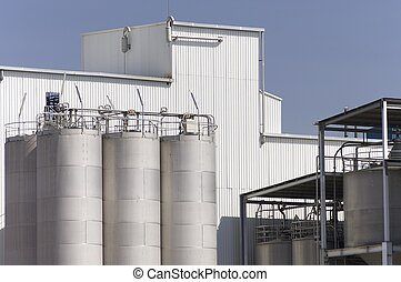 industrial area - view of huge metal tanks in an industrial...
