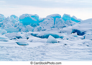 View of ice blocks cover with snow at Frozen Lake Baikal