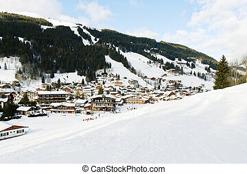 view of in mountain skiing resort town Les Gets in Portes du Soleil region, France